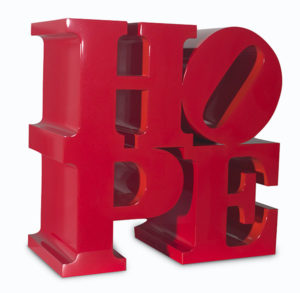 "Image of Robert Indiana's ""HOPE (Red/Orange)"" painted aluminum sculpture"